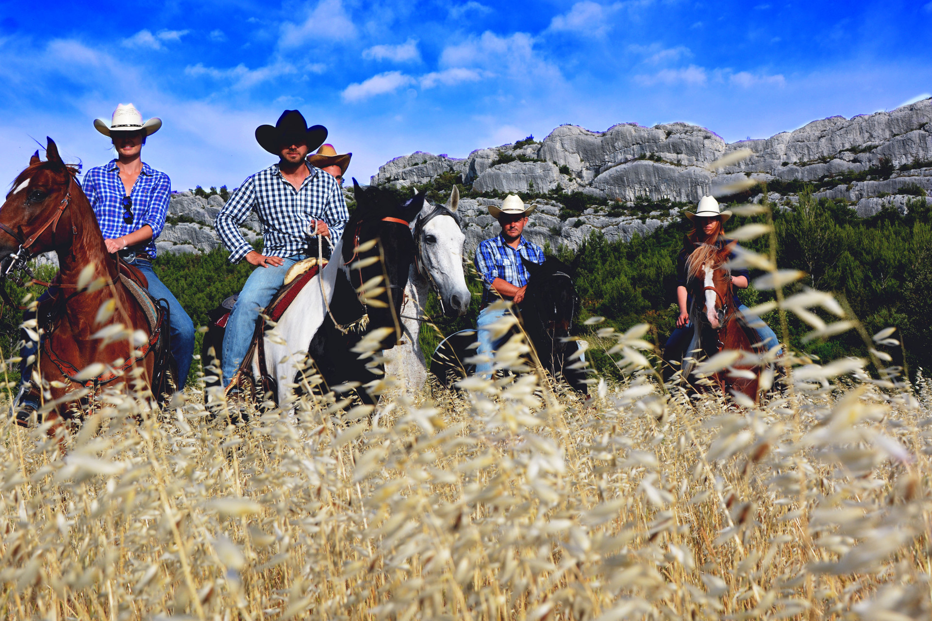 a group of western style horse riders in provence