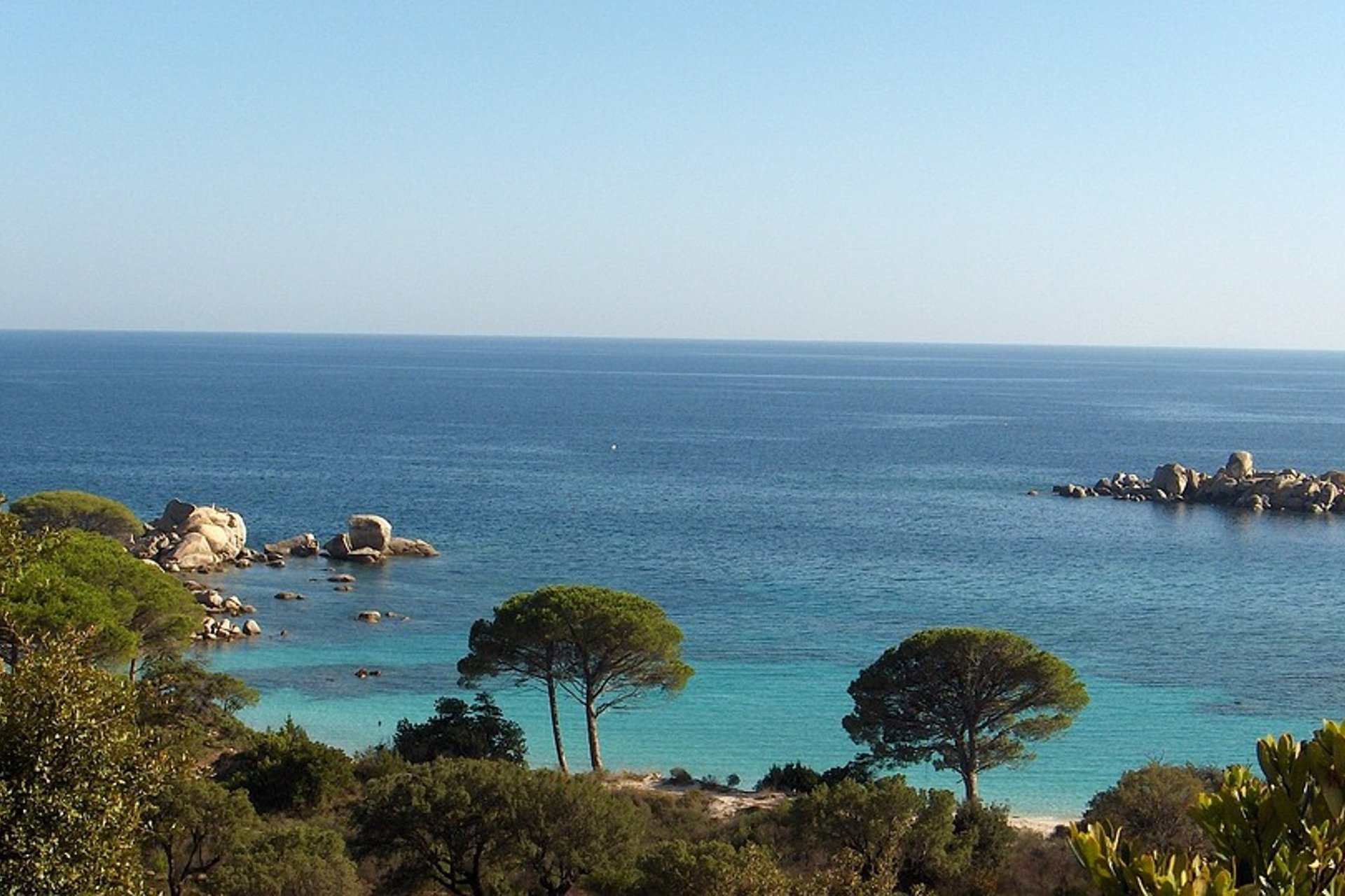 typical landscape of the corsican coast with its blue water and its vegetation