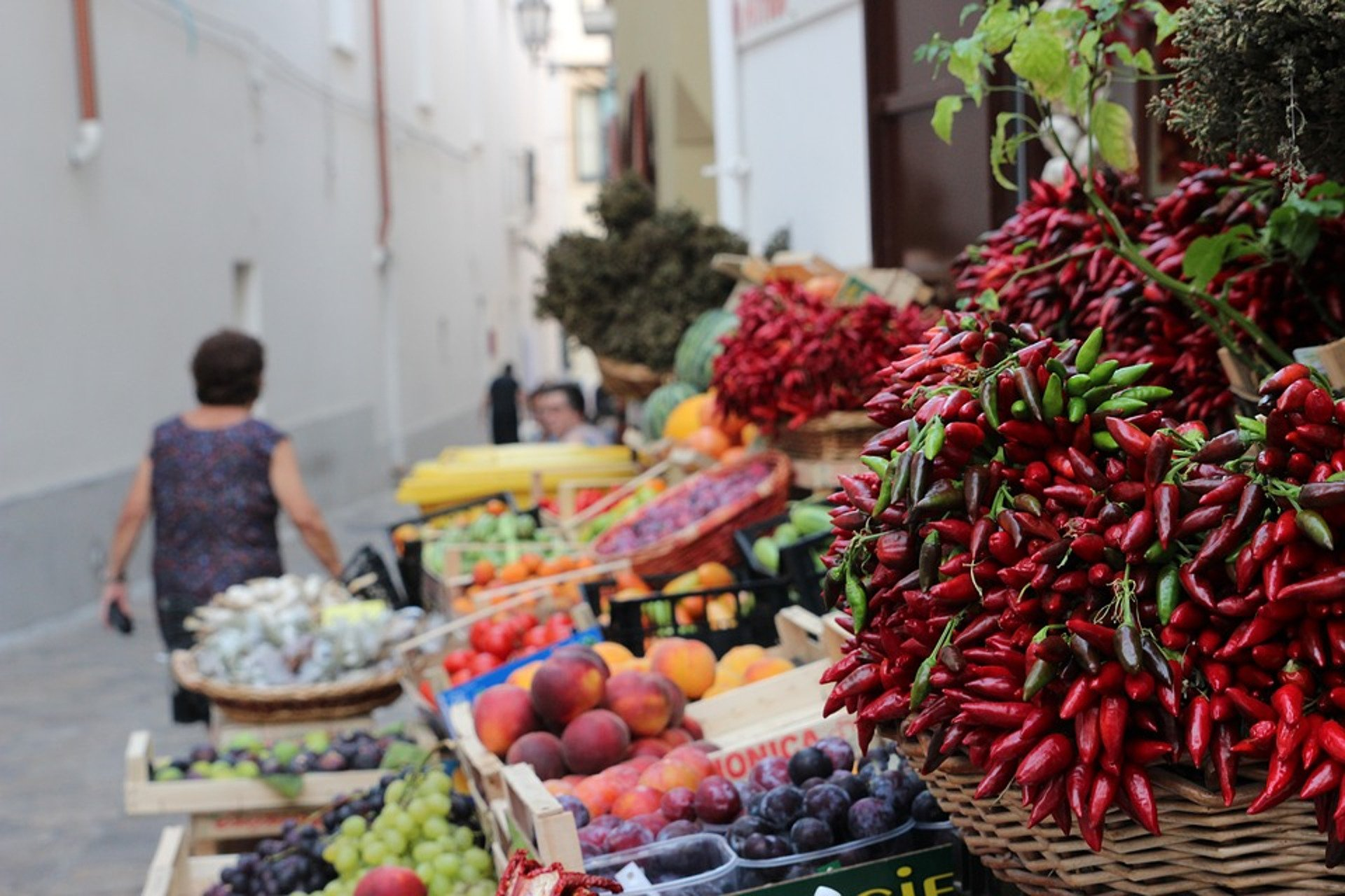the stalls of a market in a street of Ventimiglia