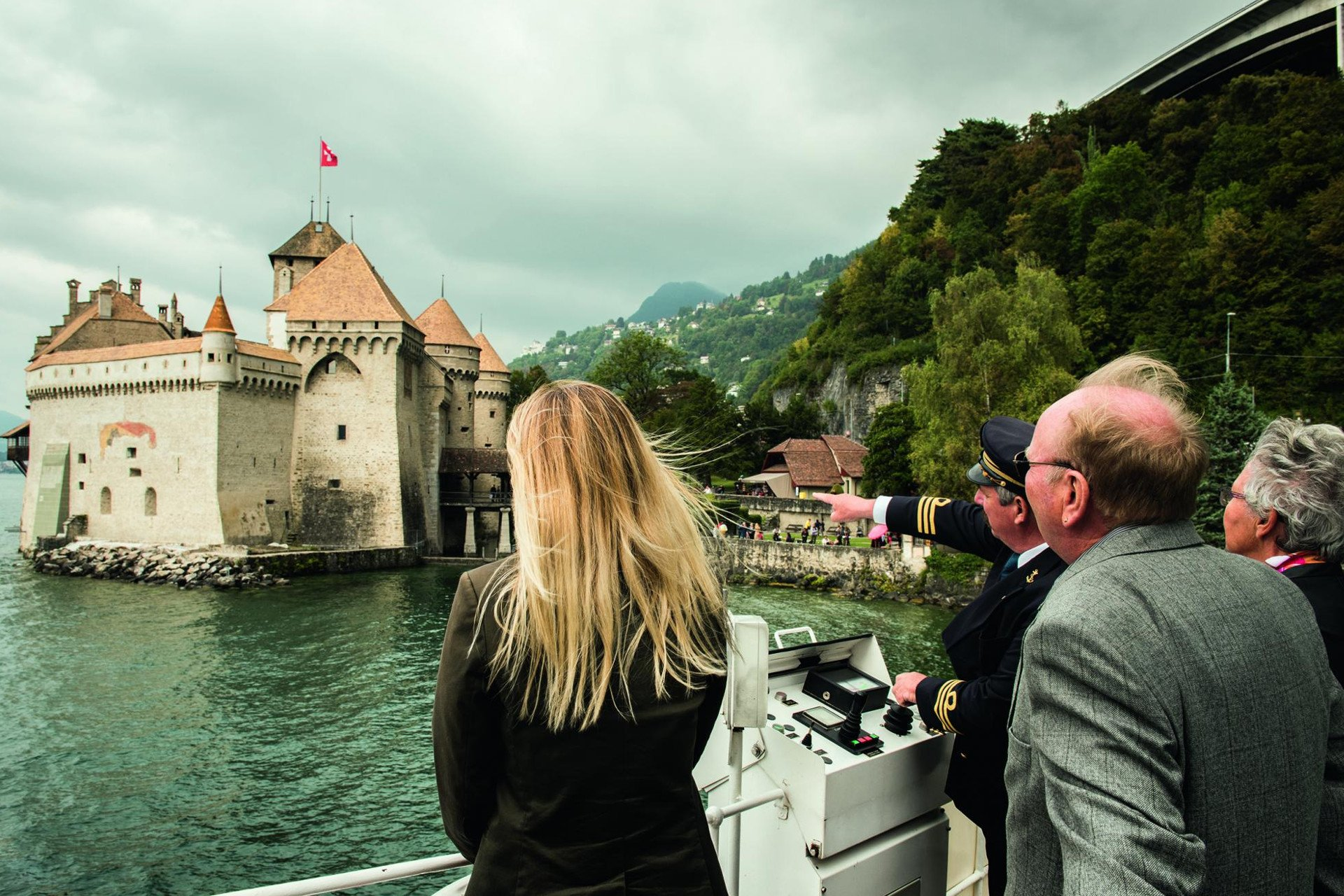 private tour-boat-captain-tourists-castle-Leman Lake-Switzerland