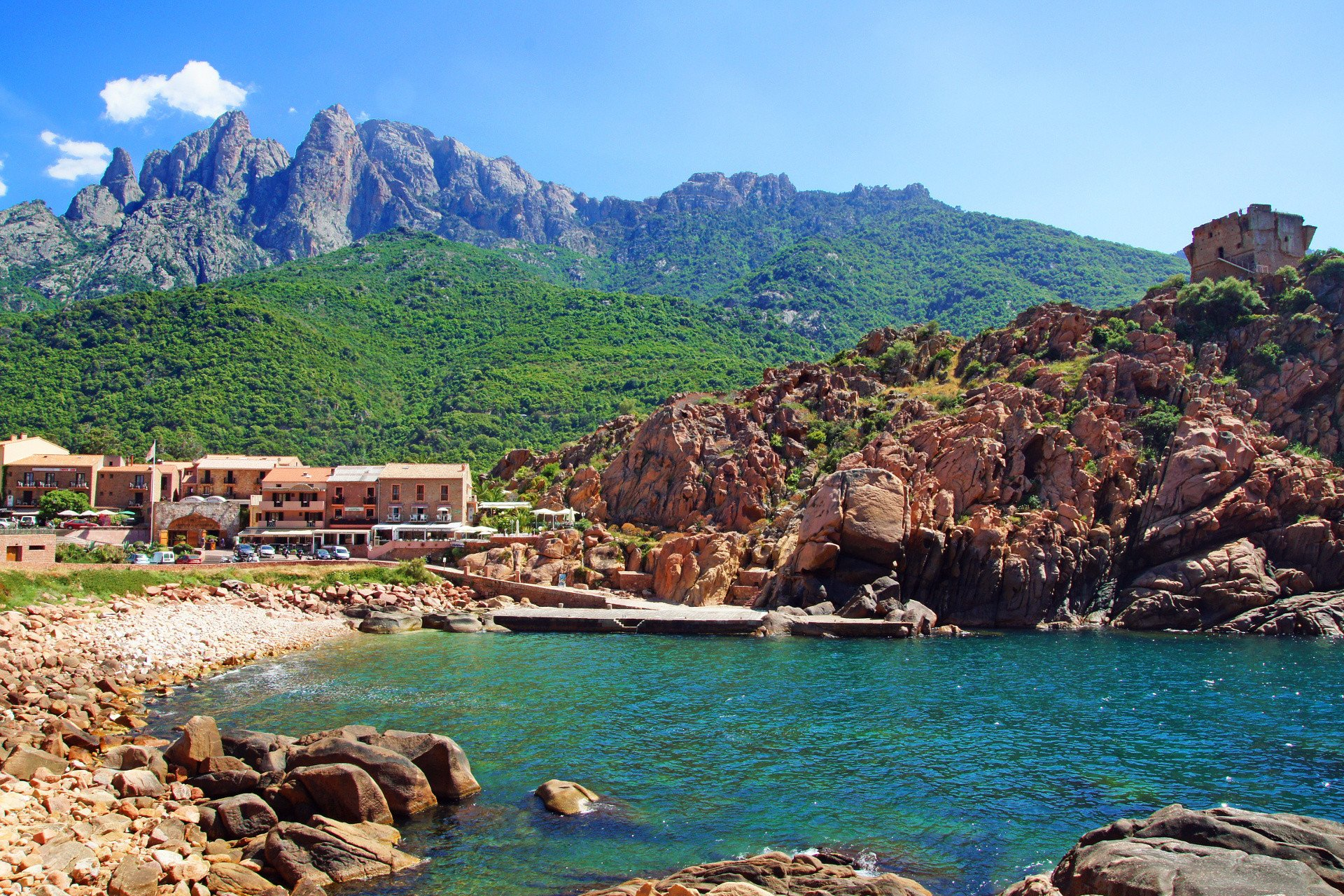 Corsican seaside village surrounded by rocky landscape
